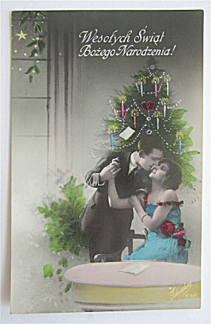 Man & Woman Kissing In Front Of Christmas Tree Postcard (Image1)