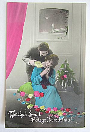 Man Giving Woman A Christmas Gift Postcard   (Image1)
