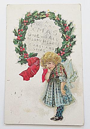 Little Girl By Christmas Wreath (Image1)