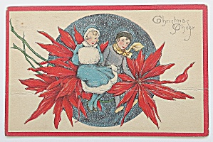 Christmas Cheer With Man & Woman Sitting On Flower