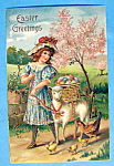 Click here to enlarge image and see more about item 10015: Easter Greetings Postcard with Girl Walking a Sheep