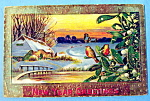 Click here to enlarge image and see more about item 10040: New Year Greetings Postcard with Town Covered in Snow