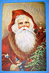 Click to view larger image of Merry Christmas Postcard w/Santa Claus Holding Toys (Image1)