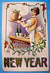 Click here to enlarge image and see more about item 10094: A Happy New Year Postcard with Woman Cooking Dinner
