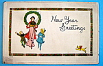 Click here to enlarge image and see more about item 10104: New Year Greetings Postcard with Mother & 2 Children