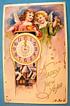 Click here to enlarge image and see more about item 10107: A Happy New Year Postcard with Two Angels & Clock