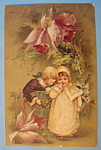 Click here to enlarge image and see more about item 10143: Best Wishes Postcard w/2 Children Under Flower
