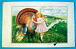 Click here to enlarge image and see more about item 10146: Thanksgiving Greetings Postcard with Girl & Turkey
