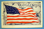 Click here to enlarge image and see more about item 10268: Old Glory Postcard which depicts American Flag