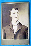 Click here to enlarge image and see more about item 10369: Wins By A Neck - Cabinet Photo of a Tall Man