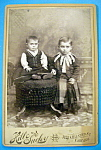 Click here to enlarge image and see more about item 10379: It's Not Funny! - Cabinet Photo of Boys In Skirts