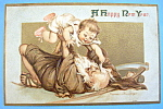 A Happy New Year Postcard w/Old Man Playing with Child