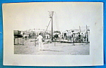 Click here to enlarge image and see more about item 11011: Photograph Of Carnival Scene with a Variety of Rides
