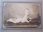 Click here to enlarge image and see more about item 1562: Photo - 1910's Baby on a Bed
