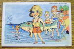 A Woman Holding A Big Fish On The Beach Postcard