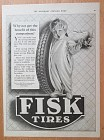 1922 Fisk Tires with Baby Holding Tire with Candle