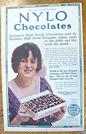 1913 Nylo Chocolates With Woman Holding Box Of Candy
