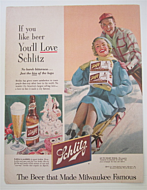 1953 Schlitz Beer with Man Pushing Woman on Sled (Image1)