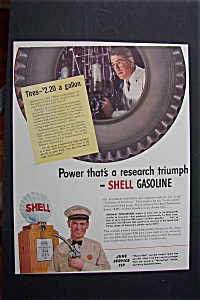 1941 Shell Gasoline With Man Looking Through Tire