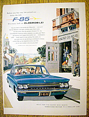 1961 Oldsmobile F-85 With Man And Family