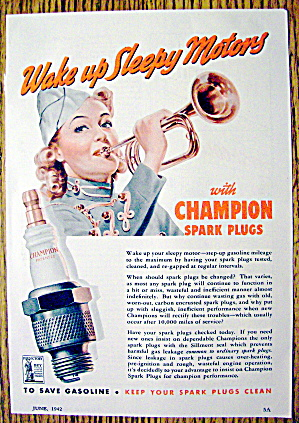 1942 Champion Spark Plugs With Woman Blowing Horn
