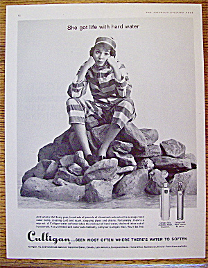1961 Culligan with woman sitting on rocks. (Image1)