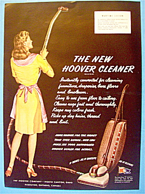 1945 New Hoover Cleaner with Woman  Vacuuming (Image1)