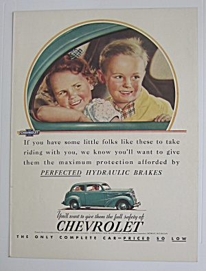 1937 Chevrolet With 2 Children Smiling