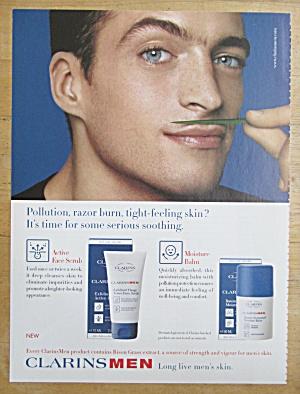 2004 Clarins Men w/Man Wearing Piece of Grass Mustache (Image1)