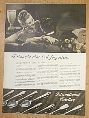 1946 International Sterling with Man & Woman on a Couch (Image1)