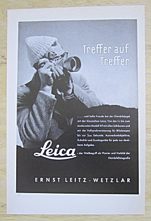 1952 Leica Camera with Man Taking  Picture with Camera (Image1)