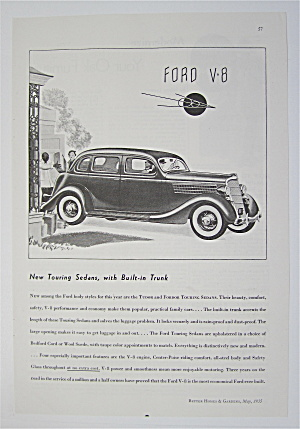 1935 Ford V-8 with Couple Driving In Car  (Image1)