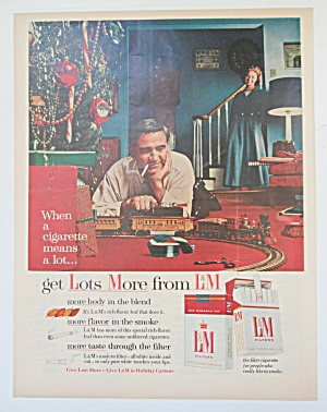 1955 L & M Cigarettes with Man Playing with Train  (Image1)
