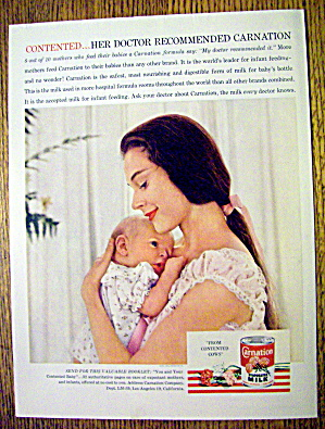 1959 Carnation Milk With Woman Holding Baby