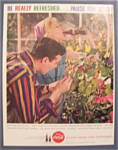 1959 Coca-cola With A Man Looking At A Flower