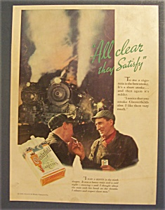 1934 Chesterfield Cigarettes W/two Men By The Railroad
