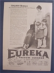 1923 Eureka Vacuum Cleaner with Woman & Children