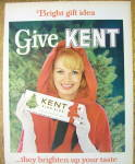 Click to view larger image of 1965 Kent Cigarettes with Woman Holding a Carton (Image2)