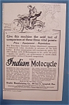 1914 Indian Motorcycle with Man Riding on Motorcycle