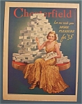 1938 Chesterfield  Cigarettes w/Woman Sitting By Stack