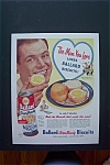 1947 Ballard Biscuits with Man Holding a Biscuit