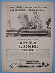 1955 Lionel Trains with a Boy Playing with a Train