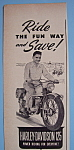 1950 Harley-Davidson 125 with Man on Motorcycle