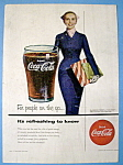 1954 Coca Cola (Coke) with a Woman Carrying a Gift Box