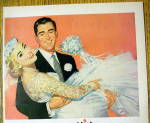 Click to view larger image of 1956 Vivid Pink Lipstick with Groom Carrying Bride (Image2)