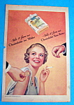 1935 Chesterfield Cigarettes w/Woman Getting Light