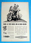 1964 Harley-Davidson Duo Glide Motorcycle with Couple