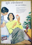 1956 Schlitz Beer with Woman Holding Present