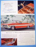 1961 Oldsmobile with the Starfire with a Man and Woman