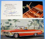 Click to view larger image of 1961 Oldsmobile with the Starfire with a Man and Woman (Image2)
